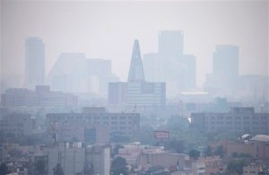 Smog blankets scyscrapers along Paseo de la Reforma in Mexico City, Thursday, March 17, 2016. An air pollution alert in greater Mexico City was extended to its fourth day, with authorities saying that despite slight improvements smog levels remained at almost 1 1/2 times acceptable limits in some areas. (AP Photo/Rebecca Blackwell)