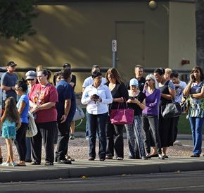 Arizona Democrats protest long poll wait for primary voting