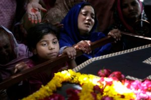 A Pakistani Christian family mourn the death of Sharmoon who was killed in a bombing attack, in Lahore, Pakistan, Monday, March 28, 2016. The death toll from a massive suicide bombing targeting Christians gathered on Easter in the eastern Pakistani city of Lahore rose on Monday as the country started observing a three-day mourning period following the attack. (AP Photo/K.M. Chaudary)