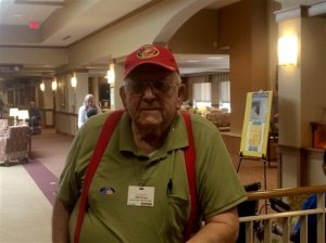 Voter Bill Weise, an 86-year-old retired Marine Corps general, pauses after casting his ballot for Ted Cruz in Virginia's Republican presidential primary, Tuesday, March 1, 2016, in Springfield, Va. Weise said he opted for Cruz over Donald Trump at the last minute, though he would have voted for Ben Carson if his campaign had stayed viable. (AP Photo/Matthew Barakat)