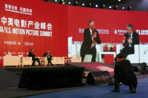 """In this Friday, March 25, 2016 photo, Dick Cook, left, chairman of Dick Cook Studios, interviews Alfonso Cuaron, director of science fiction movie """"Gravity"""" and keynote speaker, at the China-U.S. Motion Pictures Summit in northern China's Hebei province. Film Carnival, a private film company in eastern China, announced Wednesday, March 30, 2016 that it has agreed to invest at least $500 million in the studio of former Walt Disney boss Dick Cook to make movies to be distributed worldwide. (AP Photo/Louise Watt)"""