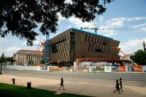 In this photo taken June 9, 2015, construction continues on The Smithsonian's National Museum of African American History and Culture in Washington, scheduled to open in 2016. The Smithsonian will display two items related to Bill Cosby at its new African-American history museum on the National Mall and has no current plans to acknowledge the sexual-assault allegations against the comedian. (AP Photo/Andrew Harnik)