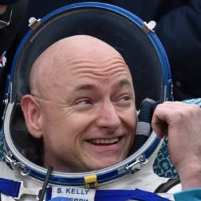 NASA spaceman back from record year flight; gives thumbs up