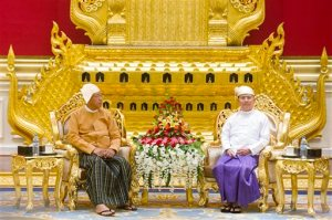 New Myanmar President Htin Kyaw, left, sits with outgoing president Thein Sein during a handover ceremony at the presidential palace in Naypyidaw on Wednesday, March 30, 2016. Htin Kyaw, a trusted friend of Nobel laureate Suu Kyi, took over as Myanmar's president Wednesday, taking a momentous step in the country's long-drawn transition toward democracy after more than a half-century of direct and indirect military rule. (Ye Aung Thu/Pool Photo via AP)