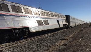 An Amtrak train derailed in southwest Kansas early Monday, March 14, 2016, injuring multiple people who were transferred to hospitals in Garden City and Dodge City, according to a release from Amtrak. The Amtrak train carrying 131 passengers derailed in rural Kansas moments after an engineer noticed a significant bend in a rail and applied the emergency brakes, an official said.   (Oliver Morrison /The Wichita Eagle via AP) LOCAL TELEVISION OUT; MAGS OUT; LOCAL RADIO OUT; LOCAL INTERNET OUT; MANDATORY CREDIT