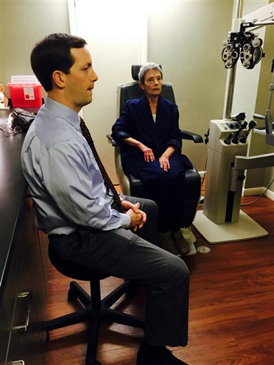 FOR RELEASE SATURDAY, MARCH 12, 2016, AT 9:00 A.M. EST.- Vistar Eye Center's Dr. Stuart Tims examines Patricia Maggard, 74, of Narrows, to determine how her right eye has healed since he placed a tiny telescope in it to improve her vision. (Luanne Rife/The Roanoke Times via AP)