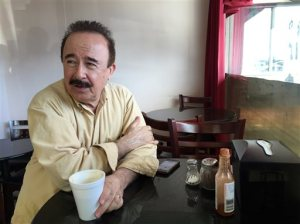 Ahmad Tarek Rashid Alam, publisher of the Arabic-language weekly community newspaper The Arab World, drinks tea at Forn Al Hara restaurant in Orange County's Little Arabia in Anaheim, Calif., on Tuesday, March 22, 2016. He comments on remarks made by GOP presidential candidate Sen. Ted Cruz about Muslim Americans in the wake of terrorist attacks in Belgium. Republican presidential candidate Ted Cruz said Tuesday that surveillance in Muslim neighborhoods in the U.S. must be intensified following the deadly bombings at Brussels, while rival Donald Trump suggested torturing a suspect in last year's Paris attacks would have prevented the carnage. (AP Photo/Gillian Flaccus)