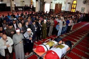 In this photo provided by the Ismailia Governor's office, citizens and dignitaries attend the funeral of Mohammed Taha Hassan Bakhit and Bassam Hindawi, two victims of a Saturday mortar attack on a checkpoint south of northern Sinai's provincial capital of el-Arish, at a mosque in Ismailiya, Egypt, Egypt, Sunday, March 20, 2016. Egypt's interior ministry said the death toll in the attack has risen to at least 15 policemen, include three officers. A Sinai-based Islamic State affiliate has claimed responsibility for the attack, according to a statement circulated on social media. The Associated Press could not independently verify the claim. (Ismailia Governor's office via AP)