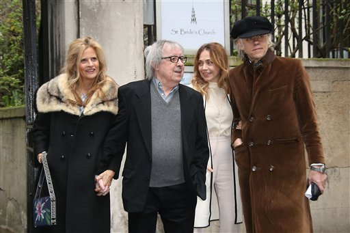 "FILE - This is  Saturday, March 5, 2016  file photo of former Rolling Stone bass player  Bill Wyman, 2nd left, Suzanne Accosta, left, Jeanne Marine, 2nd right, and Bob Geldof as they arrive at St Bride's Church for the celebration ceremony of the wedding of Rupert Murdoch and Jerry Hall in London. The Rolling Stones press office said the band's former bassist Bill Wyman has been diagnosed with prostate cancer, but is expected to make a full recovery. A statement said Tuesday March 8, 2016 that 79-year-old Wyman is undergoing treatment for the disease, which was ""caught in the early stages."" (Photo by Joel Ryan/Invision/AP, File)"