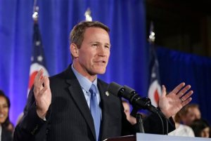 FILE - In this Nov. 4, 2014, file photo, Ohio Secretary of State Jon Husted speaks to supporters at an Ohio Republican Party celebration in Columbus, Ohio.  A policy for Ohio's youngest voters is under dispute in the swing state, causing confusion and prompting two lawsuits days before the primary election. Ohio law allows 17-year-olds who will be 18 before the fall election to vote in next week's primary, with some exceptions. Young Ohio voters can decide on congressional, legislative and mayoral contenders but can't vote on tax levies, ballot issues or a political party's central committee candidates. (AP Photo/Tony Dejak, File)