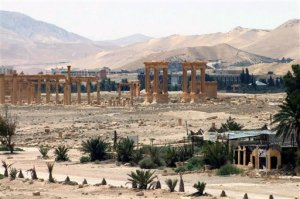 """This file photo released on Sunday, May 17, 2015, by the Syrian official news agency SANA, shows the general view of the ancient Roman city of Palmyra, northeast of Damascus, Syria. AAn Iraqi military spokesman says the long-awaited military operation to recapture the northern city of Mosul from Islamic State militants """"has begun."""" A Syrian official and a an opposition monitoring group also say Syrian government forces are trying to recapture the heart of Palmyra, controlled by the Islamic State group. (SANA via AP, File)"""