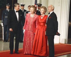 FILE - In this Nov. 16, 1988 file photo, President Ronald Reagan, left, and first lady Nancy Reagan, second right, appear with British Prime Minister Margaret Thatcher, second left, and her husband, Dennis at a state dinner at the White House in Washington. Nancy Reagan died Sunday, March 6, 2016, at the age of 94. (AP Photo/Charles Tasnadi, File)