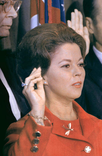 FILE - In this Sept. 16, 1969 file photo, Shirley Temple Black raises her hand at the United Nations as she is sworn in as a U.N. delegate. The child star-turned-ambassador was given the 9.54 carat blue diamond ring she is wearing in the photo by her father for her 12th birthday, and it is now going up for auction on April 19, 2016 by Sotheby's in New York. The ring, purchased in 1940 for $7,210, now has a pre-sale estimate of between $25 million and $35 million. (AP Photo, File)