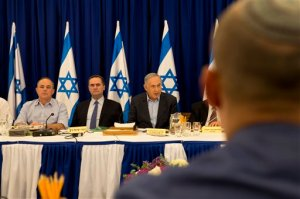 Israeli Prime Minister Benjamin Netanyahu chairs the weekly cabinet meeting in the Israeli controlled Golan Heights, Sunday, April 17, 2016. Israeli Prime Minister Israeli Prime Minister Benjamin Netanyahu said Sunday his country will never withdraw from the war won Golan Heights and the strategic plateau bordering Syria will forever stay in Israeli hands. (AP Photo/Sebastian Scheiner, Pool)