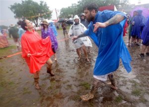 Tamar Maya and Bryan Avendano dance in the rain during the New Orleans Jazz and Heritage Festival at the Fair Grounds in New Orleans on Thursday, April 28, 2016. (Brett Duke,/NOLA.com The Times-Picayune via AP) MAGS OUT; NO SALES; USA TODAY OUT; THE BATON ROUGE ADVOCATE OUT; THE NEW ORLEANS ADVOCATE OUT; MANDATORY CREDIT