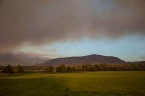 In this Wednesday, April 20, 2016 photo, smoke fills the sky as a forest fire burns in the Shenandoah National Park near Elkton, Va. Crews with the Virginia Department of Forestry worked Wednesday to contain the wildfire. (Michelle Mitchell/News-Virginian via AP)
