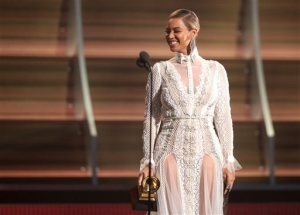 "FILE - In this Feb. 15, 2016, file photo, Beyoncé presents the award for record of the year at the 58th annual Grammy Awards in Los Angeles. After the recent debut of her visual album ""Lemonade"" on HBO, a Ticketmaster representative told The Associated Press on Wednesday, April 27, that the ticket outlet company saw searches for Beyoncé's concerts increased by 116 percent compared to last week. (Photo by Matt Sayles/Invision/AP, File)"