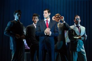 """This image released by Jeffrey Richards Associates shows, from left, Alex Michael Stoll, Dave Thomas Brown, Benjamin Walker, Jordan Dean and Theo Stockman during a performance of """"American Psycho."""" (Jeremy Daniel/Jeffrey Richards Associates via AP)"""