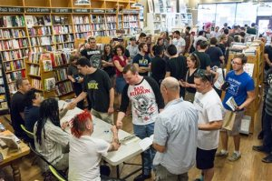 "Fans line up to get autographs from members of the punk band NOFX at a book signing at Parnassus Books in Nashville, Tenn., on Tuesday, April 26, 2016. At front table from left are Erik ""Smelly"" Sandin, Aaron ""El Hefe"" Abeyta, Eric Melvin, and ""Fat Mike"" Burkett. (AP Photo/Erik Schelzig)"