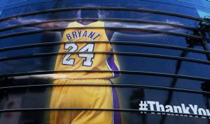 A giant banner congratulating Kobe Bryant is draped around Staples Center before his last NBA basketball game, a contest against the Utah Jazz, in downtown Los Angeles on Wednesday, April 13, 2016. Many of Bryant's fans - even some of the adults - have never known Los Angeles without him. It's a feeling they're about to have to get used to as fans celebrate his final night as a Laker. (AP Photo/Richard Vogel)