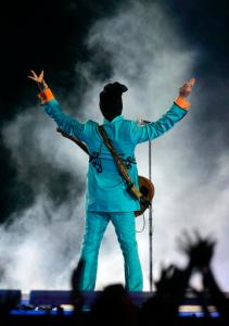 FILE - In this Feb. 4, 2007 file photo, Prince performs during the halftime show at Super Bowl XLI at Dolphin Stadium in Miami. Since Prince died, YouTube and other uploading sites have been flooded with hundreds of hours of the superstar musician's songs, concert footage, TV appearances and music videos. It's a sign that the notoriously tight copyright controls the artist maintained over his material is rapidly loosening, and raising hope that hardcore fans might someday hear the Holy Grail of Prince's music: unreleased recordings from the vault at Paisley Park. (AP Photo/Chris Carlson, File)