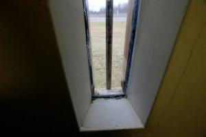 """FILE - In this Feb. 25, 2016 file photo, fences with barbed wire are visible from the window of a cell in what prison officials describe as a disciplinary confinement area rather than solitary confinement, at the Rhode Island Department of Corrections High Security Center, in Cranston, R.I. Roberta Richman, a former warden who spent 33 years working in the state Department of Corrections who retired in 2012, testified Wednesday night, April 6, 2016, in favor of legislation that would limit the isolation of inmates to no more than 15 days at a time. """"Too many inmates come out of isolation angrier and more dangerous than they were when they went in,"""" Richman said. (AP Photo/Steven Senne, File)"""