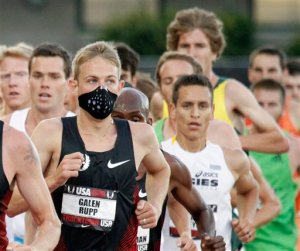 FILE - In this June 23, 2011 file photo, a runner wears a mask for allergies during the U.S. track and field championships in Eugene, Ore. A report issued Monday, April 4, 2016, by the Obama Administration listed how global warming will make the air dirtier, water more contaminated and food more tainted. It warned of diseases, such as those spread by ticks and mosquitoes, longer allergy seasons, and thousands of heat wave deaths.  (AP Photo/Don Ryan, File)