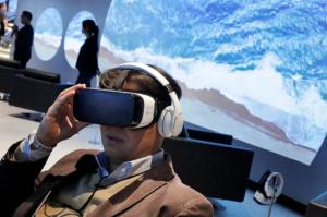 FILE - In this Monday, Feb 22, 2016, file photo, a Samsung Gear VR oculus is demonstrated during a preview of Samsung's flagship store, Samsung 837, in New York's Meatpacking District. VR is clearly a medium in its infancy and creators are still devising new storytelling techniques that can exploit the technology's power. But it's impossible to deny the technology's underlying potential. (AP Photo/Richard Drew, File)