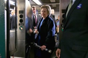 """FILE - In this April 7, 2016 file photo, Democratic presidential candidate Hillary Clinton holds her Metrocard as she goes through the turnstile to enter the subway in the Bronx borough of New York. Clinton, Bernie Sanders and Donald Trump are all boasting about their New York City credentials. But who really makes the cut as  a local legend? We put the candidates to the test with a """"New Yorker Scorecard.""""  (AP Photo/Richard Drew, File)"""