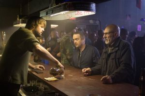 """This image released by A24 Films shows, from left, Jake Kasch, Macon Blair and Patrick Stewart in a scene from, """"Green Room."""" (Scott Green/A24 via AP)"""
