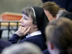 Kimberly Miller, a Philadelphia nun and teacher at Little Flower High School for Girls in the city, looks on before appearing in Washington Township Municipal Court, in Washington Township, N.J., Wednesday, April 13, 2016. Miller has been charged with driving under the influence and related charges. (Tim Hawk/NJ.com via AP, Pool)