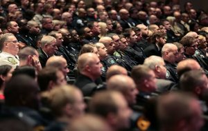 Local law enforcement and officers from across the country attend a memorial service for Virginia State Trooper Chad Dermyer at Liberty Baptist Church Tuesday, April 5, 2016, in Hampton, Va. Dermyer was killed in the line of duty at the Richmond Greyhound bus station last week. (Rob Ostermaier /The Daily Press via AP, Pool)