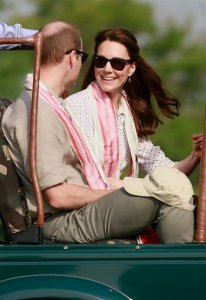 Britain's Prince William, left, along with Kate, the Duchess of Cambridge, prepare to set off on a jeep safari at Kaziranga National Park, northeastern Assam state, India Wednesday, April 13, 2016. Prince William and his wife, Kate, planned their visit to Kaziranga specifically to focus global attention on conservation. The 480-square-kilometer (185-square-mile) grassland park is home to the world's largest population of rare, one-horned rhinos as well as other endangered species including swamp deer and the Hoolock gibbon. (AP Photo/Anupam Nath)