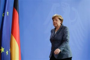 German Chancellor Angela Merkel leaves after a statement at the chancellery in Berlin, Friday, April 15, 2016. Chancellor Angela Merkel says the German government has granted a Turkish request to allow the possible prosecution of  German TV comedian Jan Boehmermann, who wrote a crude poem about Turkey's president. (AP Photo/Markus Schreiber)