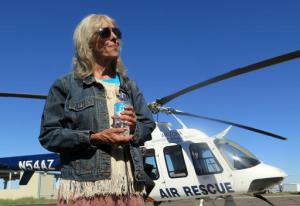 Ann Rodgers recalls being lost in the eastern Arizona mountains for nine days before being rescued, while speaking at the Arizona Department of Public Safety hangar in Tucson International Airport Wednesday, April 13, 2016. Rodgers, of Tucson, Ariz., was headed to Phoenix and got lost near the White Mountains east of the Phoenix area. Her hybrid car ran out of gas and electric power, leaving her stranded in the middle of nowhere. Rodgers was rescued on April 9. (AP Photo/Astrid Galvan)