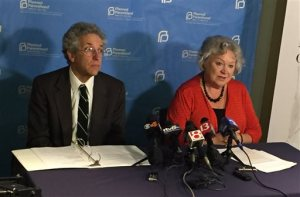Planned Parenthood of Indiana and Kentucky Legal Director Ken Falk, left, and the organization's president Betty Cockrum talk to reporters, Thursday, April 7, 2016 in the Planned Parenthood office in downtown Indianapolis. The organization filed a lawsuit against Indiana over a controversial abortion law recently signed by Gov. Mike Pence. (AP Photo/Aric Chokey)