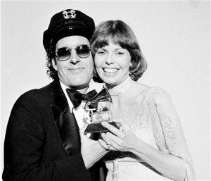 "FILE - In this Feb. 28, 1976 file photo, Daryl Dragon and his wife Toni Tennille, of the Captain & Tennille, hold the Grammy award they won  for record of the year for ""Love Will Keep Us Together,"" at the Grammy Awards ceremony in Los Angeles.  Tennille has written a memoir, ""Toni Tennille,"" which details her relationship  with Dragon. (AP Photo, FIle)"