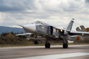 FILE - In this Jan. 20, 2016 file photo, a Russian Su-24 bomber lands at Hemeimeem air base in Syria. U.S. officials say a pair of Russian Su-24 attack planes buzzed a U.S. Navy destroyer in the Baltic Sea multiple times on Monday, April 11, 2016, and Tuesday, April 12, 2016.  (AP Photo/Vladimir Isachenkov, File)