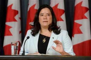 Canada's Justice Minister Jody Wilson-Raybould speaks at a news conference in Ottawa on Thursday, April 14, 2016. Canada has introduced a new assisted suicide law that will only apply to Canadians and residents, meaning Americans won't be able to travel to Canada to die. Visitors will be excluded under the proposed law announced Thursday, precluding the prospect of suicide tourism. Canadian government officials said to take advantage of the law the person would have to be eligible for health services in Canada.  (Adrian Wyld /The Canadian Press via AP) MANDATORY CREDIT