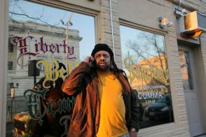 FILE - In this March 7, 2016 file photo, Ed Forchion, a pro-marijuana activist dubbed NJ Weedman, stands in front of his Liberty Bell Temple and Sanctuary, next to his Weedman's Joint restaurant in Trenton, N.J. Forchion has been arrested again on marijuana charges after law enforcement raided his restaurant and cannabis temple Wednesday, April 27, 2016. He was arrested along with 10 other people after a raid of his business, officials announced Thursday. (AP Photo/Mel Evans, File)