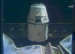 In this frame taken from video from NASA TV, the SpaceX Dragon cargo ship approaches the International Space Station, Sunday April 10, 2016. A SpaceX Dragon cargo ship arrived at the International Space Station on Sunday, two days after launching from Cape Canaveral, Florida. Station astronauts used a big robot arm to capture the Dragon, orbiting 260 miles above Earth. (NASA TV via AP)