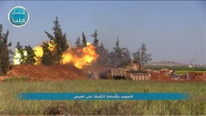 "This image posted on the Twitter page of Syria's al-Qaida-linked Nusra Front on Friday, April 1, 2016, shows Nusra Front tank fires at Syrian troops and pro-government gunmen in the northern village of al-Ais in Aleppo province, Syria. The Britain-based Syrian Observatory for Human Rights says 12 Hezbollah fighters were killed and dozens were wounded in Saturday's attack by militants led by al-Qaida's Syria branch — known as the Nusra Front — on the northern village of al-Ais. The title in Arabic that reads ""introduction attacks with heavy weapons on al-Ais."" (Al-Nusra Front via AP)"