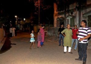 Residents who rushed outdoors following tremors stand on a road outside their houses in Kolkata, India, Wednesday, April 13, 2016. A strong earthquake struck Myanmar on Wednesday night and was felt in parts of eastern India and Bangladesh, causing residents to rush out of their homes in panic. There were no immediate reports of injuries or damage.(AP Photo/Bikas Das)