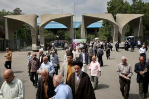 Iranian worshippers leave the Tehran University campus at the conclusion of their Friday prayer in Tehran, Iran, Friday, April 29, 2016. Iranians voted Friday in the country's parliamentary runoff elections, a key polling that is expected to decide exactly how much power moderate forces backing President Hassan Rouhani will have in the next legislature. (AP Photo/Ebrahim Noroozi)