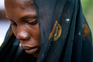 A girl identified as Monica, cries as her story of escaping the Boko Haram is told during a Bring Back Our Girls vigil in Abuja, Nigeria, Thursday, April 21, 2016, which, two years after Boko Haram abducted the girls from their school, is still held daily. A total of 219 girls remain missing, and Power said she couldn't imagine the frustration of the families. (AP Photo/Andrew Harnik)
