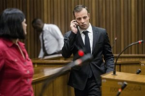 Oscar Pistorius talks on a mobile phone after a hearing at the High Court in Pretoria, South Africa on Monday, April 18, 2016. The South African former Olympic track star Oscar Pistorius appeared briefly in court where a judge scheduled five days in June to determine his sentence for the conviction of murdering his girlfriend. (Marco Longari/Pool Photo via AP)