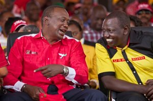 FILE - In this Saturday, March 2, 2013 file photo, Kenya's then Presidential candidate Uhuru Kenyatta, left, and his running mate William Ruto talk together at the final election rally of Kenyatta's The National Alliance party at Uhuru Park in Nairobi, Kenya. The International Criminal Court has terminated the case against Kenya's deputy president William Ruto and ended his trial, saying there is insufficient evidence he was involved in deadly violence that erupted after his country's 2007 presidential elections.  The announcement  Tuesday April 5, 2016 marks the second time the court has had to admit defeat in its attempts to prosecute alleged ringleaders of the violence that left more than 1,000 people dead and forced 600,000 from their homes in Kenya.(AP Photo/Ben Curtis, File)