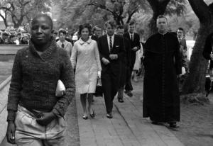 FILE - In this June 5, 1966 file photo Sen. Robert F. Kennedy, back right, and his wife, Ethel, back left, arrive at the Roman Catholic Cathedral in Pretoria, South Africa, during a visit to the country. In 1966 Kennedy traveled to apartheid South Africa and spoke about equality and the rule of law. This week members of his family are in democratic South Africa to mark the 50th anniversary of that visit. (AP Photo)
