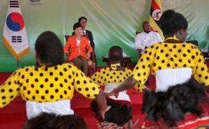 South Korea's president Park Geun-hye, center left, and Uganda's President Yoweri Museveni, center right, attend a ceremony to open the South Korea-funded National Farmers Leadership Centre at Kampiringisa, south-west of the capital Kampala, in Uganda, Monday, May 30, 2016. Uganda is cutting military, but not diplomatic, ties with North Korea to comply with U.N. sanctions over North Korea's nuclear program, a Ugandan official said Monday following a meeting between Museveni and South Korea's visiting president. (AP Photo/Stephen Wandera)