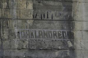 In this Monday, May 16, 2016 photo, some graffiti left by hobos are seen under the bridge in Los Angeles. The writings and drawings, some dating to 1914, were written with utensils like grease pencils or etched into the concrete under a 103-year-old bridge spanning the Los Angeles River. (AP Photo/Jae C. Hong)